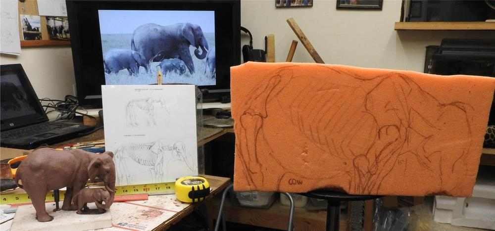 Starting with a block of foam and all reference images for the maquette - Running Wild Studio Audubon Elephant Sculpture Elephant Zoo Sculpture