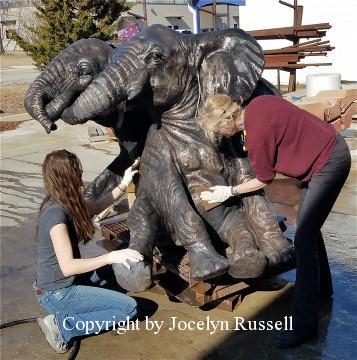 Kristen helps me scrub out the highlights - Audubon Zoo Elephant Sculpture Project - Running Wild Studio