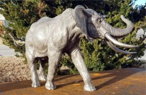 "Nguvu (Power) - Audubon Bull Elephant Maquette 21""H x 34""L x 18""W- Edition of 24 - Running Wild Studio Life-size Elephant Bronze Sculpture Elephant Family in Bronze"